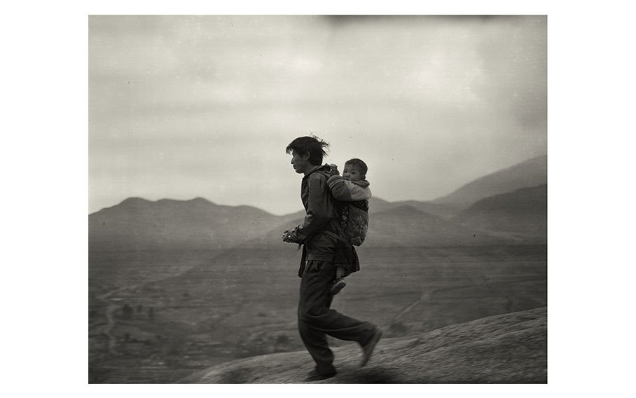 Adou, Father And Son, 2006, silver gelatin print